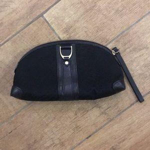 Cole Haan black cosmetic bag.
